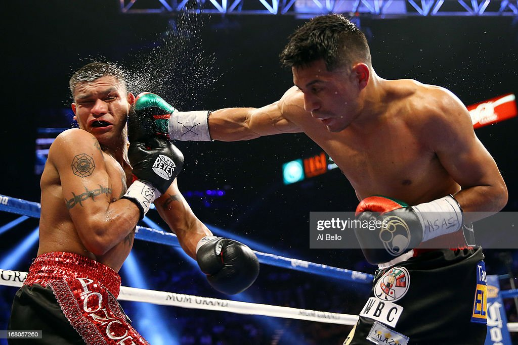 Abner Mares connects with a right to the face of Daniel Ponce de Leon in their WBC featherweight title bout at the MGM Grand Garden Arena on May 4, 2013 in Las Vegas, Nevada.