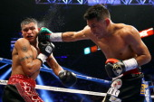 Abner Mares connects with a right to the face of Daniel Ponce de Leon in their WBC featherweight title bout at the MGM Grand Garden Arena on May 4...