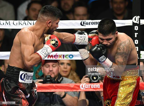 Abner Mares hits Jose Ramirez in the fifth round of their super featherweight fight at the MGM Grand Garden Arena on December 13 2014 in Las Vegas...