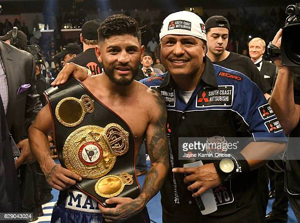 Abner Mares in the ring with his trainer Robert Garcia after he defeated Jesus Cuellar in the WBA Featherweight Championship Bout at the Galen Center...