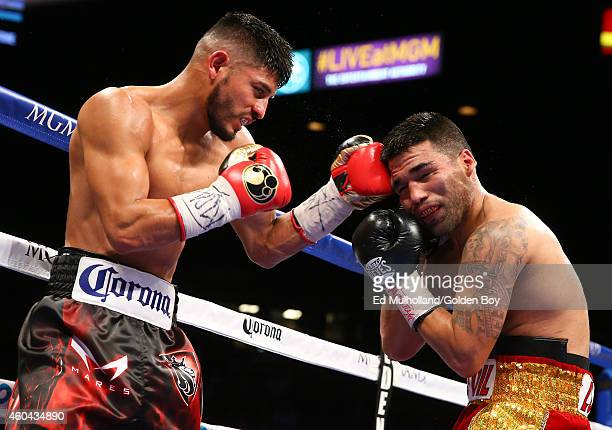 Abner Mares lands a left hand to the head of Jose Ramirez during their super featherweight fight at the MGM Grand Garden Arena on December 13 2014 in...