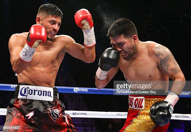 Abner Mares lands a left uppercut to the head of Jose Ramirez during their super featherweight fight at the MGM Grand Garden Arena on December 13...