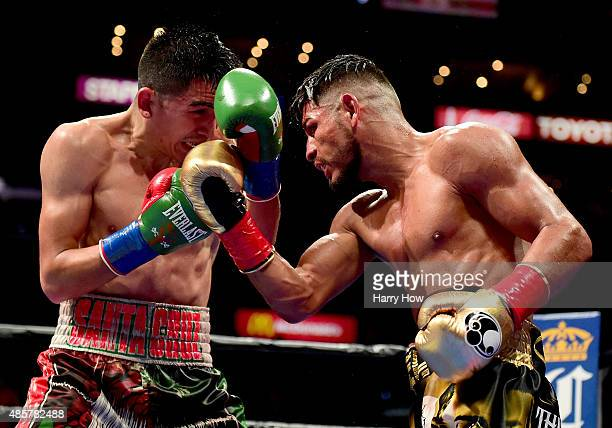Abner Mares of Mexico punches Leo Santa Cruz during the ninth round of the WBC diamond featherweight and WBA featherweight championship bout at...