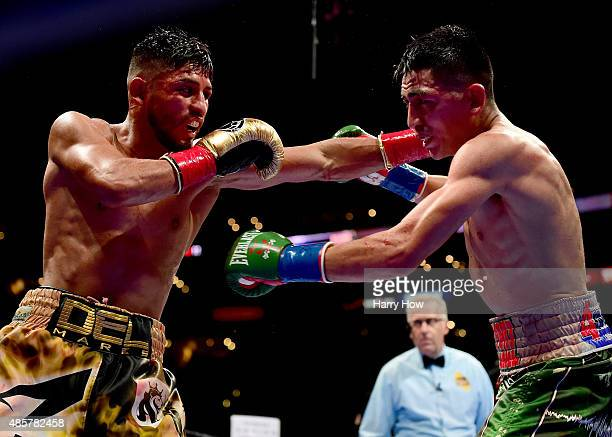 Abner Mares of Mexico punches Leo Santa Cruz in the 11th round during the WBC diamond featherweight and WBA featherweight championship bout at...