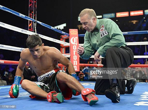 Abner Mares receives a count from referee Jack Reiss before he is knocked out by Jhonny Gonzalez in the first round during the WBC Featherweight...