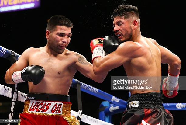 Abner Mares takes a left hand from Jose Ramirez during their super featherweight fight at the MGM Grand Garden Arena on December 13 2014 in Las Vegas...