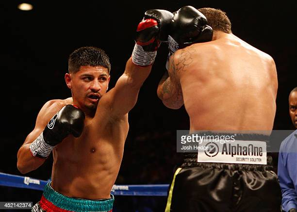 Abner Mares throws a left at Jonathan Oquendo during their featherweight bout at the MGM Grand Garden Arena on July 12 2014 in Las Vegas Nevada