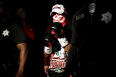 Abner Mares wears a mask before he enters the ring to take on Daniel Ponce de Leon in their WBC featherweight title bout at the MGM Grand Garden...