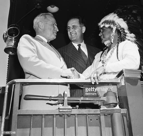 Aboard his homewardbound train during the 1948 presidential campaign President Harry Truman receives a blanket and a handshake from Navajo Chief John...