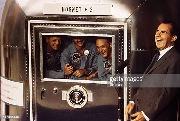 A happy President Richard M Nixon laughs with Apollo 11 astronauts left to right Neil A Armstrong Michael Collins and Buzz Aldrin as they exchange...