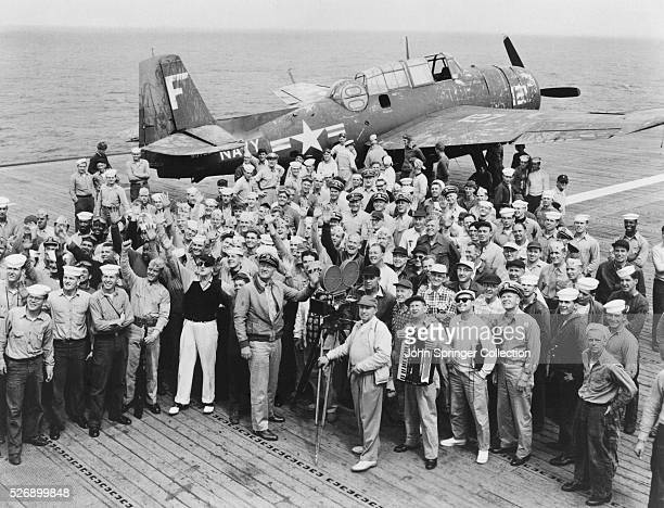 ABOARDThe cast and crew of MGM's 'The Wings of Eagles' aboard the USS Philippine Sea pose with the crew of the aircraft carrier which plays a...
