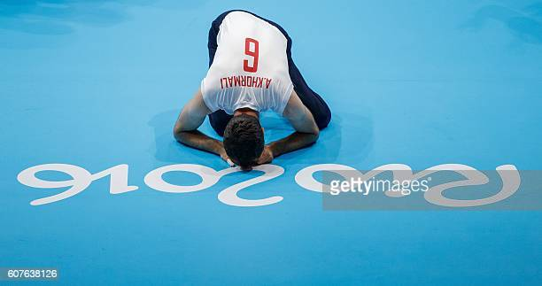 TOPSHOT Abolfazl Oliyaei of Iran says a small prayer after his team's victory in the men's sitting volleyball gold medal match 18 between Bosnia and...