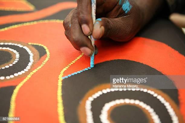 Aboriginal Artist Painting at Ngurratjuta Iltja Ntjarra Many Hands Art Centre