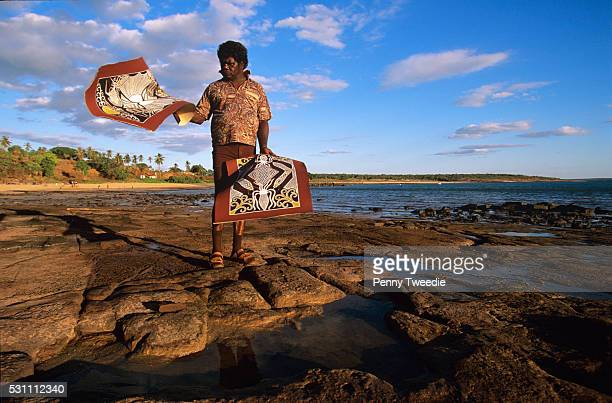 Aboriginal artist Terry Yumbulul with his paintings of octapus and crayfish from the reef Galiwinku island Arnhem Land Terry is elder of and...