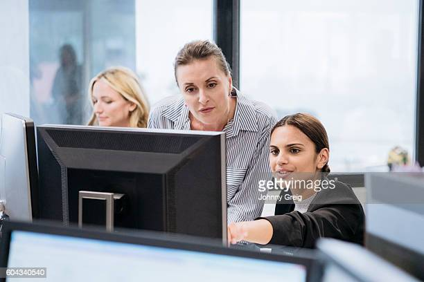 Aboriginal Australian businesswoman using computer with female colleague