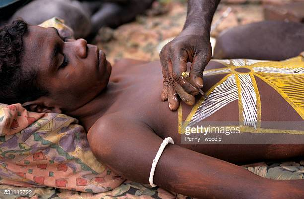Aboriginal boy Jazmin being painted for his important initiation and circumcism ceremony at Yathalamarra Arnhem Land This is the most important...
