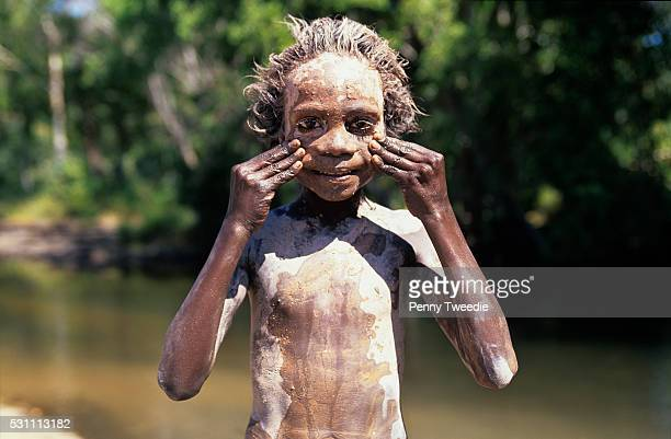 Aboriginal boy Mathew covering himself with white clay at Dukaladjarranj central Arnhem Land On returning to their clan country the children nearly...