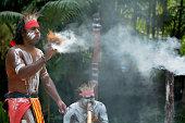 Yugambeh Aboriginal warrior demonstrate  fire making craft during Aboriginal culture show in Queensland, Australia.