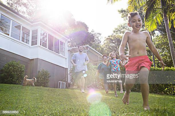 Aboriginal family having fun in the garden at home