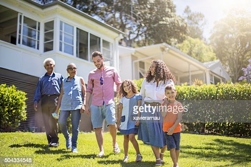 Aboriginal Family Walking In The Garden At Home Stock Photo Getty Images