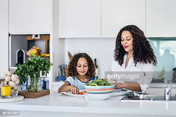 Aboriginal mother and daughter preparing a fresh salad