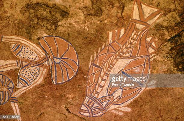 Aboriginal Rock Paintings of Barramundi Fish and Dreamtime Figure