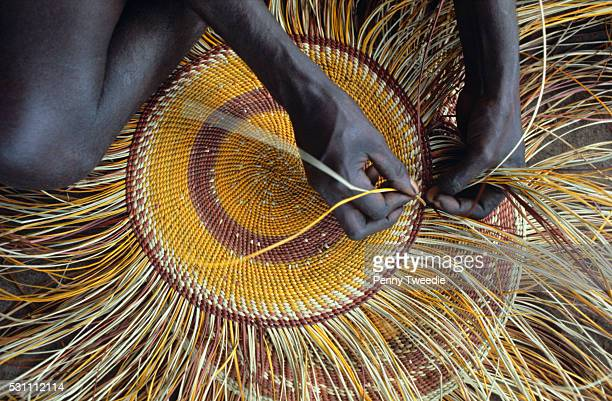 Aboriginal woman weaving a pandanus mat in Arnhem Land Traditionally these mats were used to sleep on and carry things but now they are made to sell...