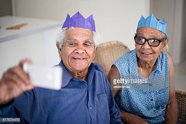 Aborigine couple taking a selfie for Christmas