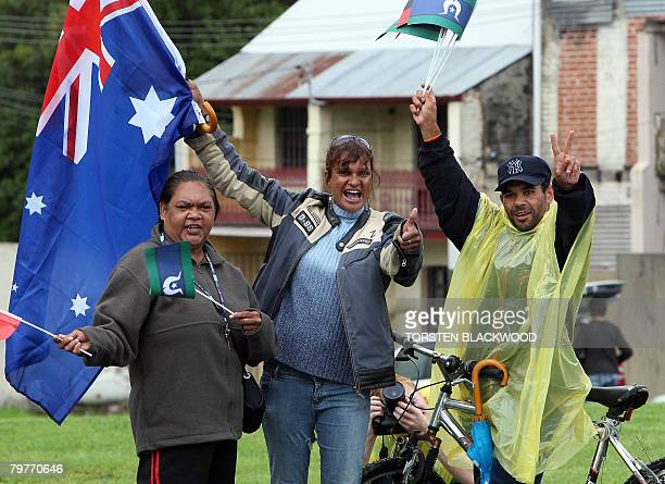 Aborigines display Australian Aboriginal and Torres Strait Islander flags after hearing Australian Prime Minister Kevin Rudd deliver an historic...