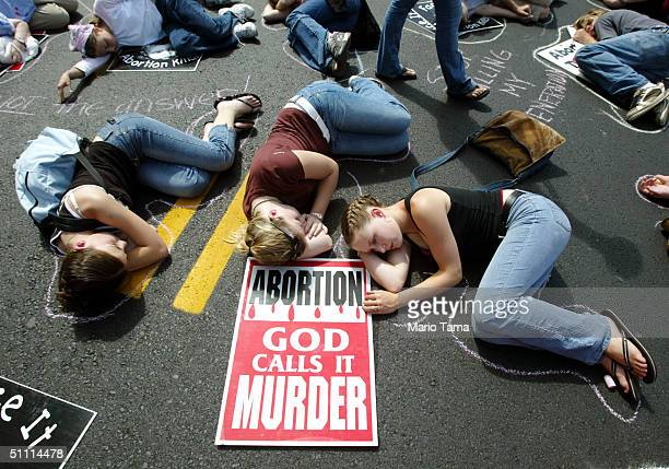 Abortion protesters lay on the street to symbolize dead fetuses outside the FleetCenter a day before the Democratic National Convention July 25 2004...