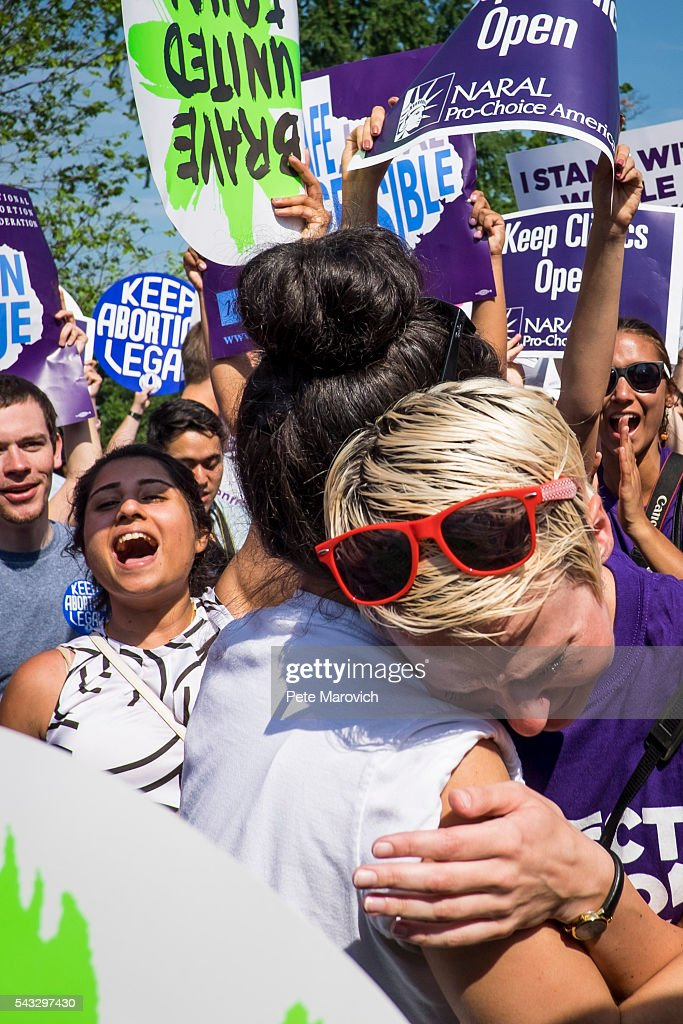 Abortion rights activists Morgan Hopkins of Boston, left, and Alison Turkos of New York City, celebrate on the steps of the United States Supreme Court on June 27, 2016 in Washington, DC. In a 5-3 decision, the U.S. Supreme Court struck down one of the nation's toughest restrictions on abortion, a Texas law that women's groups said would have forced more than three-quarters of the state's clinics to close.