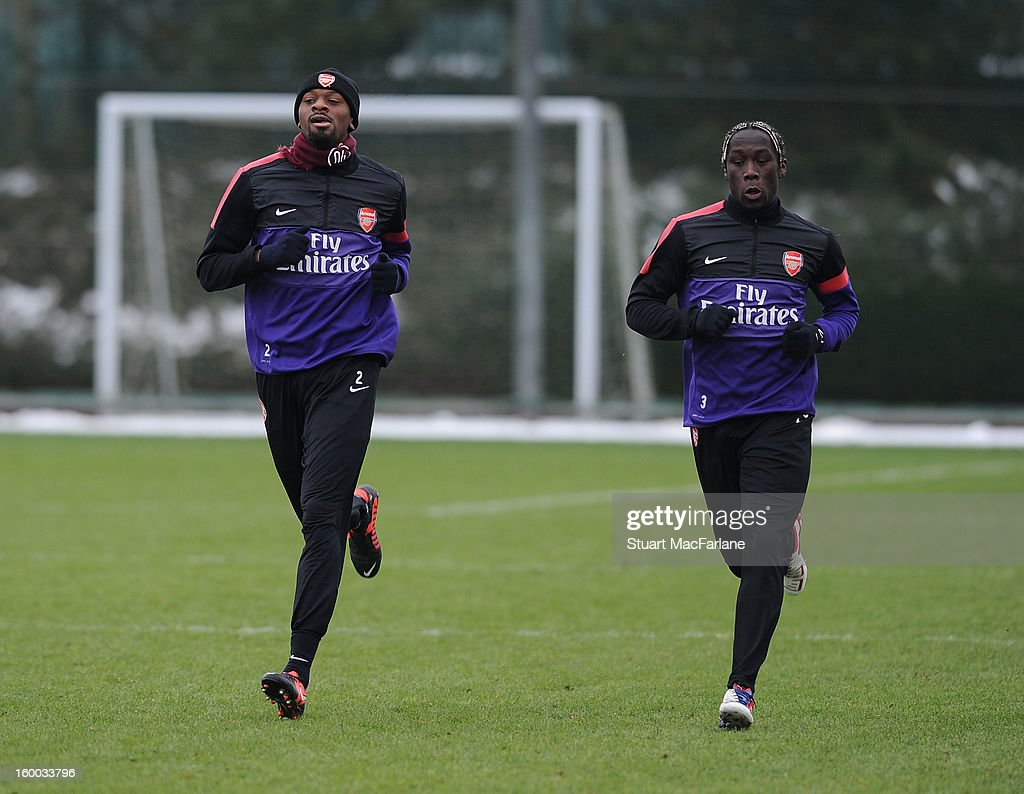 Abou Diaby and Bacary Sagna of Arsenal during a training session at London Colney on January 25, 2013 in St Albans, England.