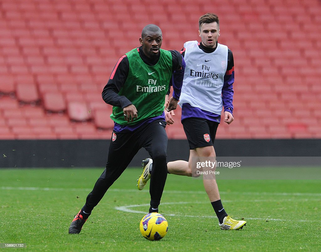 Abou Diaby and Carl Jenkinson of Arsenal in action during a training session at Emirates Stadium on January 03, 2013 in London, England.