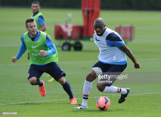 Abou Diaby and Jack Wilshere of Arsenal during the Arsenal 1st Team Training Session at London Colney on May 14 2014 in St Albans England