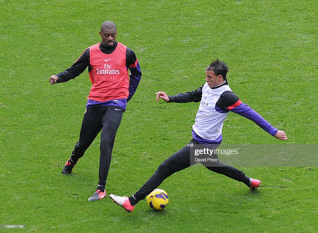 Abou Diaby and Marouane Chamakh of Arsenal in action during a training session at Emirates Stadium on January 03, 2013 in London, England.