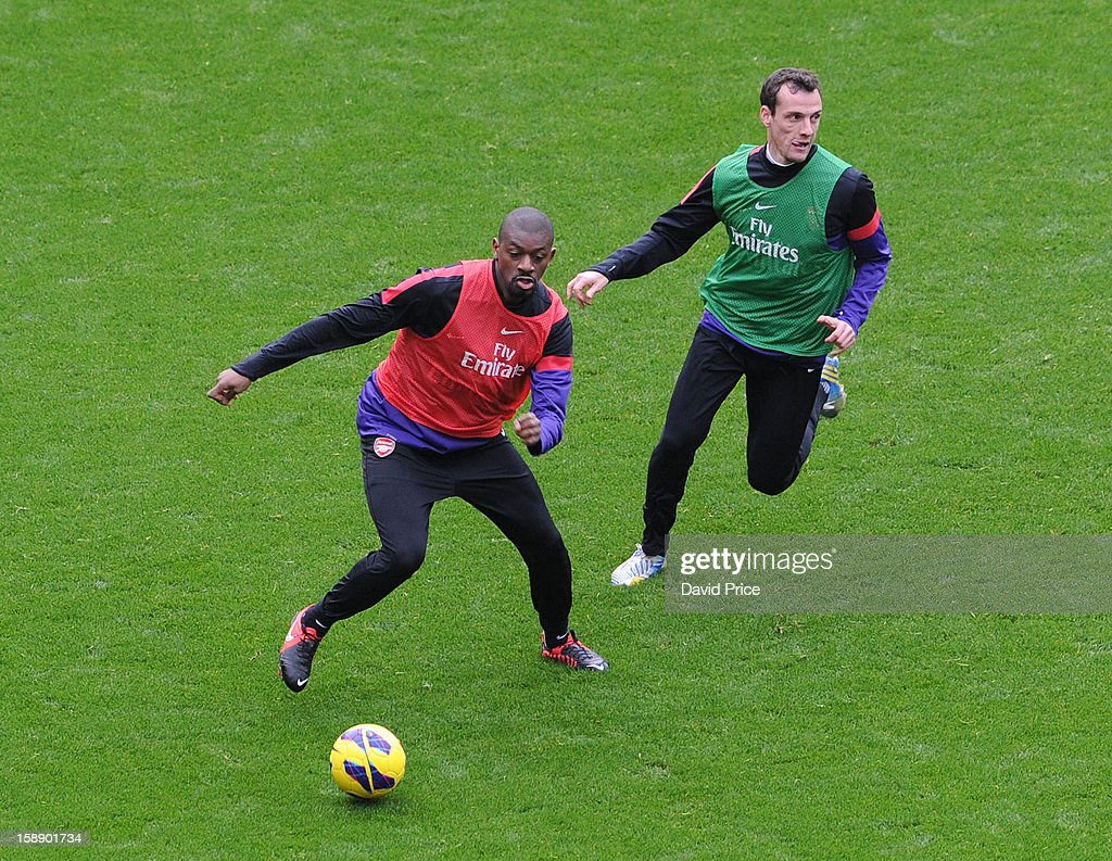 Abou Diaby and Sebastien Squillaci of Arsenal in action during a training session at Emirates Stadium on January 03, 2013 in London, England.