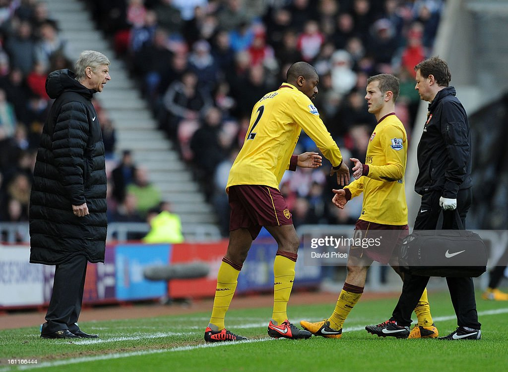 Abou Diaby comes on for Jack Wilshere of Arsenal as Arsenal Manager Arsene Wenger looks on during the Barclays Premier League match between Sunderland and Arsenal at Stadium of Light on February 09, 2013 in Sunderland, England.
