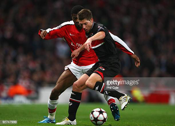 Abou Diaby of Arsenal battles for the ball with Stijn Schaars of AZ Alkmaar during the UEFA Champions League Group H match between Arsenal and AZ...