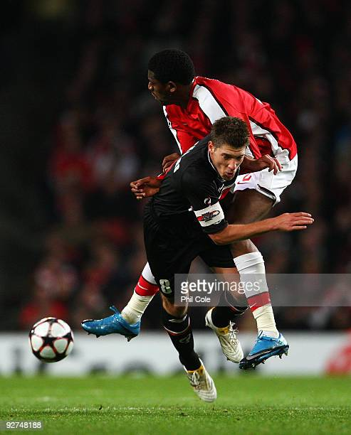 Abou Diaby of Arsenal colides with Stijn Schaars of AZ Alkmaar during the UEFA Champions League Group H match between Arsenal and AZ Alkmaar at the...