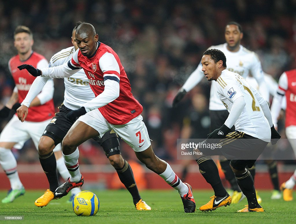 <a gi-track='captionPersonalityLinkClicked' href=/galleries/search?phrase=Abou+Diaby&family=editorial&specificpeople=658258 ng-click='$event.stopPropagation()'>Abou Diaby</a> of Arsenal cuts inside Jonathan De Guzman of Swansea during the FA Cup Third Round Replay match between Arsenal and Swansea City at the Emirates Stadium on January 16, 2013 in London, England.