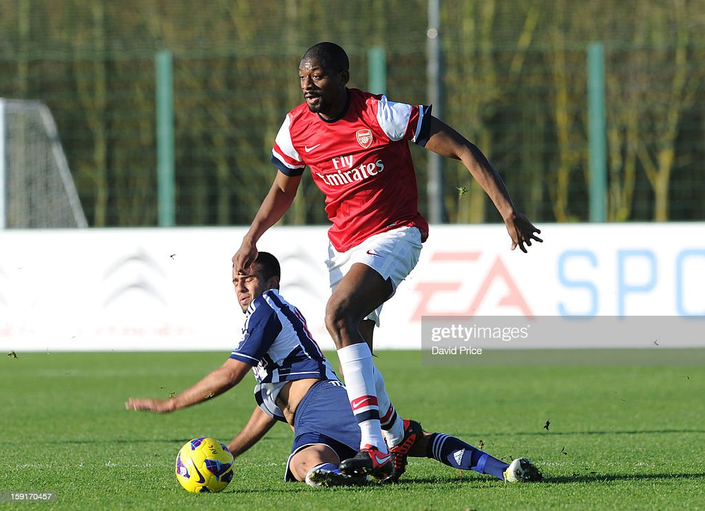 <a gi-track='captionPersonalityLinkClicked' href=/galleries/search?phrase=Abou+Diaby&family=editorial&specificpeople=658258 ng-click='$event.stopPropagation()'>Abou Diaby</a> of Arsenal rides the tackle from Adil Nabi of WBA during the Barclays Premier U21 match between Arsenal U21 and West Bromwich Albion U21 at London Colney on January 9, 2013 in St Albans, United Kingdom.