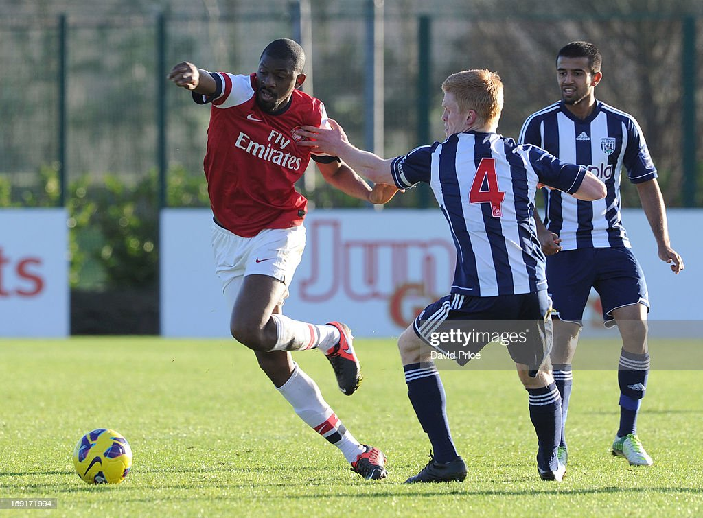 <a gi-track='captionPersonalityLinkClicked' href=/galleries/search?phrase=Abou+Diaby&family=editorial&specificpeople=658258 ng-click='$event.stopPropagation()'>Abou Diaby</a> of Arsenal skips round Liam O'Neil as Adil Nabi of WBA looks on during the Barclays Premier U21 match between Arsenal U21 and West Bromwich Albion U21 at London Colney on January 9, 2013 in St Albans, United Kingdom.