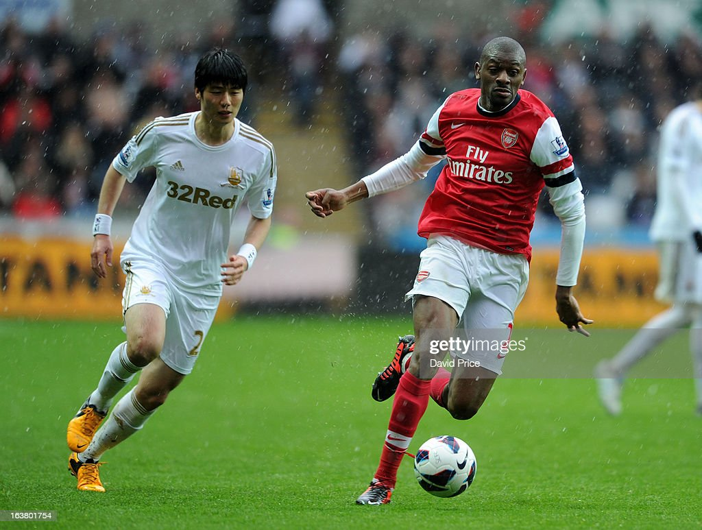 <a gi-track='captionPersonalityLinkClicked' href=/galleries/search?phrase=Abou+Diaby&family=editorial&specificpeople=658258 ng-click='$event.stopPropagation()'>Abou Diaby</a> of Arsenal surges past Ki Sung-Yueng of Swansea during the Premier League match between Swansea City and Arsenal at Liberty Stadium on March 16, 2013 in Swansea, Wales.
