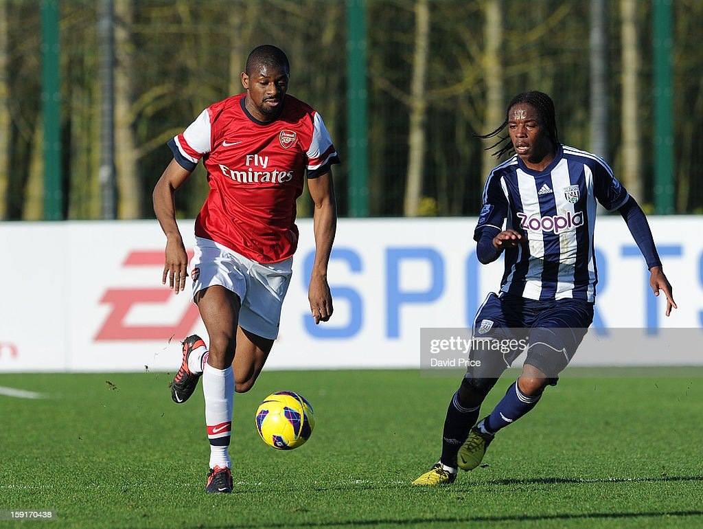 Abou Diaby of Arsenal takes on Romaine Sawyers of WBA during the Barclays Premier U21 match between Arsenal U21 and West Bromwich Albion U21 at London Colney on January 9, 2013 in St Albans, United Kingdom.