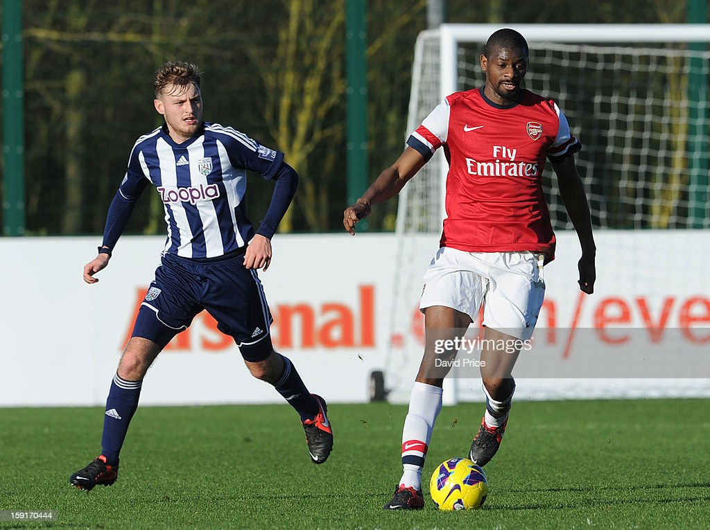 Abou Diaby of Arsenal turns away from Aaron Birch of WBA during the Barclays Premier U21 match between Arsenal U21 and West Bromwich Albion U21 at London Colney on January 9, 2013 in St Albans, United Kingdom.