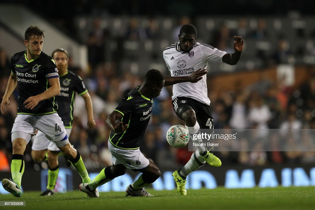 Aboubakar Kamara of Fulham takes on Marc Bola of Bristol Rovers during the Carabao Cup Second Round match between Fulham and Bristol Rovers at Craven Cottage on August 22, 2017 in London, England.