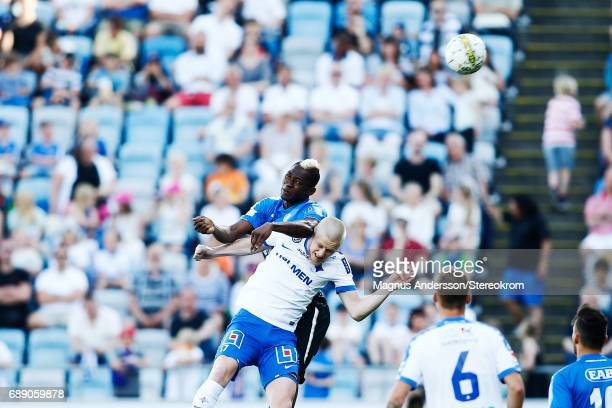 Aboubakar Keita of Halmstad BK and Kalle Holmberg of IFK Norrkoping competes for the ball during the Allsvenskan match between IFK Norrkoping and...