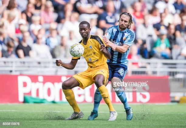 Aboubakar Keita of Halmstad BK and Kevin Walker of Djurgardens IF under the Allsvenskan match between Djurgardens IF and Halmstad BK at Tele2 Arena...