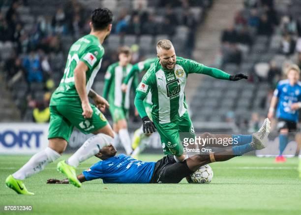 Aboubakar Keita of Halmstad BK and Sander Svendsen of Hammarby IF during the Allsvenskan match between Hammarby IF and Halmstad BK at Tele2 Arena on...
