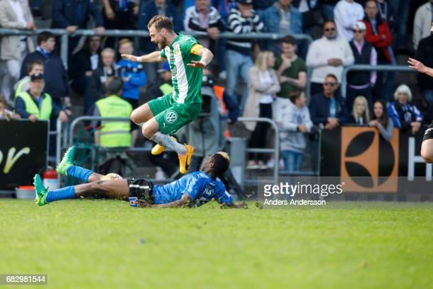 Aboubakar Keita of Halmstad BK slide tackles Arnór Smárason of Hammarby IF during the Allsvenskan match between Halmstad BK and Hammarby IF at Orjans...